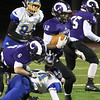 Shawsheen Tech vs Assabet Valley football. Shawsheen's Patrick O'Leary (6) and Diondre TUrner (12), and Assabet's Scott Giusti (84) and Justin Giusti (24), bottom.  (SUN/Julia Malakie)