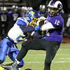 Shawsheen Tech vs Assabet Valley football. Assabet's Nick Carvalho (26) tackles Shawsheen's Diondre Turner (12).  (SUN/Julia Malakie)