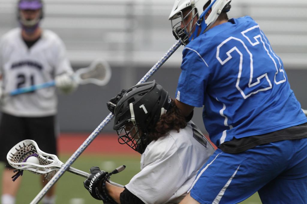 . Shawsheen Tech vs Bedford lacrosse. Shawsheen\'s Owen Sullivan (7) and Bedford\'s Joe Hegarty (27). (SUN/Julia Malakie)