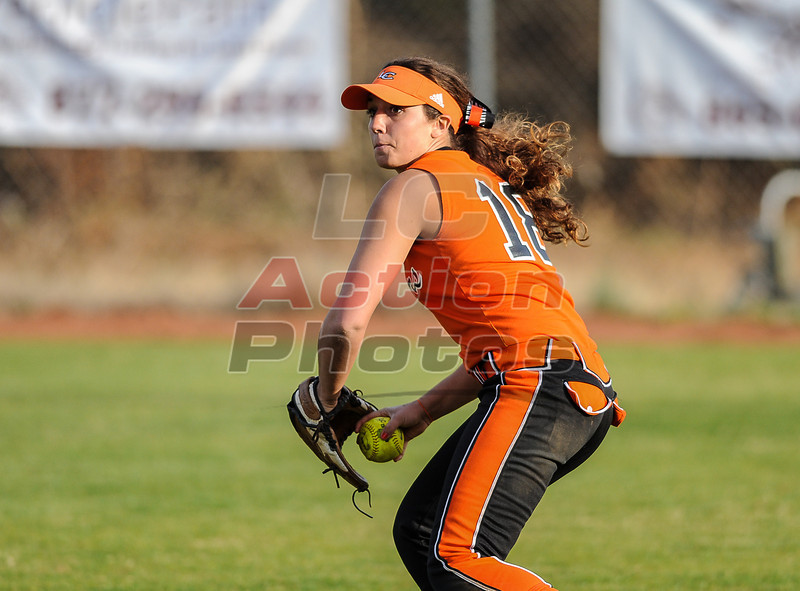Sarah Hurt plays a ball hit to right field