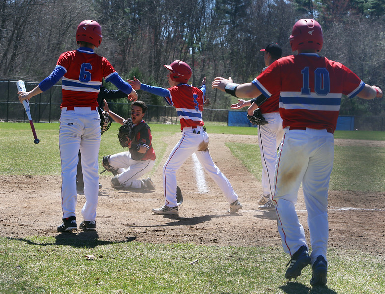 Tewksbury vs North Andover baseball. Tewksbury's Nolan Timmons (6), Matt Cahill (5) and Ryne Rametta (10) react after Cahill was tagged out at the plate by North Andover catcher Jack Moric (35) in the bottom of the third inning.(SUN/Julia Malakie)