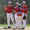 Tewksbury vs North Andover baseball. Tewksbury third baseman Garrett Kingston (7) cleans sand out of his shoe while waiting for a change of pitchers with Matt Perron, rear, Kyle Zervas (21) and Mike Polimeno (11). (SUN/Julia Malakie)