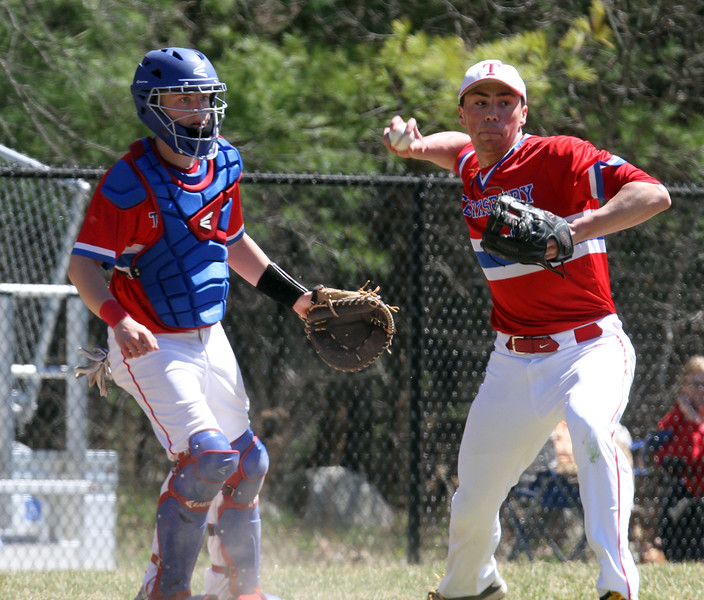 Tewksbury vs North Andover baseball. Tewksbury catcher Ryne Rametta looks on as relief pitcher Chad Boschetti (23) fields a dribbler down the third base line that stayed fair, for the final out in the top of the seventh inning. (SUN/Julia Malakie)