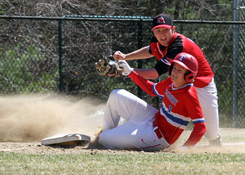 Tewksbury vs North Andover baseball. Tewksbury baserunner Garrett Kingston (7) is out trying to reach third from first when the batter's fly ball was bobbled by North Andover center fielder. Fielding is third baseman Jackson Berberich (5), in the bottom of the sixth inning. (SUN/Julia Malakie)