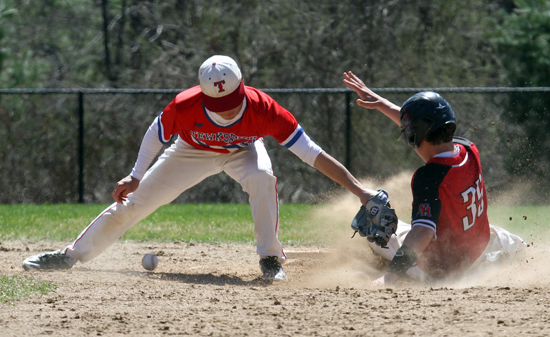 Tewksbury vs North Andover baseball. Tewksbury second baseman Kyle Zervas (21) tags North Andover baserunner Jack Moric (35) without the ball. Moric was safe with a stolen base in the top of the fifth inning. (SUN/Julia Malakie)