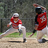 Tewksbury vs North Andover baseball. Tewksbury second baseman Kyle Zervas (21) can't hang onto the ball and North Andover baserunner Jack Moric is safe with a stolen base in the top of the fifth inning. (SUN/Julia Malakie)