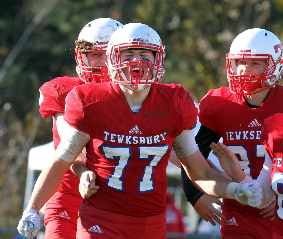 . Tewksbury vs Beverly football in Division 3 semifinal of MIAA state tournament. Tewksbury\'s Connor Nugent (77) reacts after blocking a punt and recovering the ball in the second quarter. (SUN/Julia Malakie)