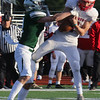 Tewksbury vs Duxbury football in Division 3 state semifinal at Xavierian Brothers High School. Tewksbury's Nolan Timmons (7) hangs onto this pass as he's tackled by Duxbury's Jack Murphy (2). (SUN/Julia Malakie)
