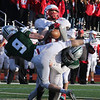 Tewksbury vs Duxbury football in Division 3 state semifinal at Xavierian Brothers High School. Pass intended for Tewksbury's Owen Gilligan (87) is incomplete, as he's tackled by Duxbury's Ryan Prudente (9) and Sam Heppenstall (15). (SUN/Julia Malakie)