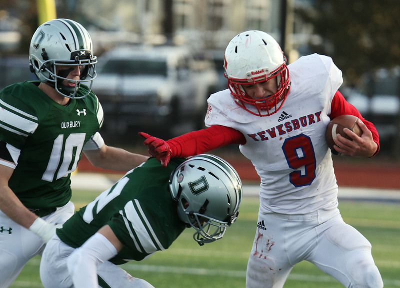 Tewksbury vs Duxbury football in Division 3 state semifinal at Xavierian Brothers High School. Tewksbury's Danny Fleming (9), tackled by Duxbury's Pang Campbell (22), and Seamus Johnston (10). (SUN/Julia Malakie)