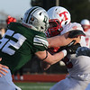 Tewksbury vs Duxbury football in Division 3 state semifinal at Xavierian Brothers High School. Tewksbury's William McKay (2), right, is tackled by Duxbury's Christian Fahey (52), after McKay intercepted a Duxbury pass. (SUN/Julia Malakie)
