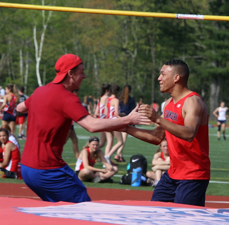 ". Tewksbury vs North Andover girls and boys track & field. Tewksbury\'s Masyn Lorick, right, is congratulated by Brendan Murray, a coach, after clearing 6\'6"" in High Jump. (SUN/Julia Malakie)"