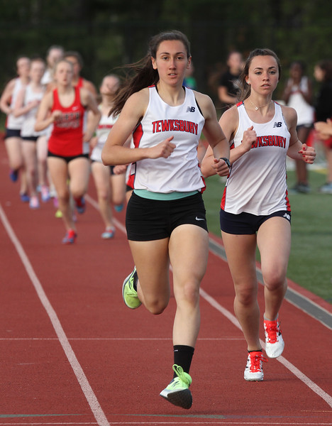 Tewksbury vs North Andover girls and boys track & field. Rachel Sessa, left, and Isabelle Carleton of Tewksbury, after one lap of the 800M. They finished first and second respectively. (SUN/Julia Malakie)