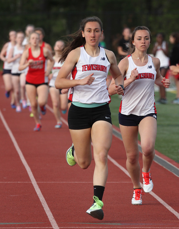 . Tewksbury vs North Andover girls and boys track & field. Rachel Sessa, left, and Isabelle Carleton of Tewksbury, after one lap of the 800M. They finished first and second respectively. (SUN/Julia Malakie)