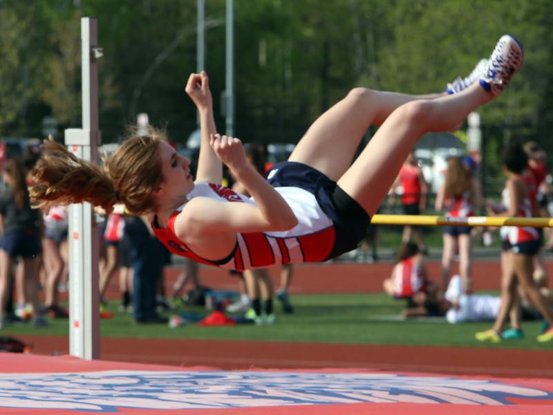 Tewksbury vs North Andover girls and boys track & field. Kerry Shea of Tewksbury in High Jump. (SUN/Julia Malakie)
