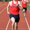 Tewksbury vs North Andover girls and boys track & field. Joey Forest of Tewksbury wins the Mile. (SUN/Julia Malakie)