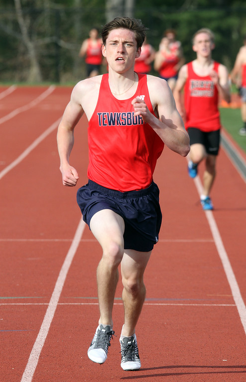 . Tewksbury vs North Andover girls and boys track & field. Joey Forest of Tewksbury wins the Mile. (SUN/Julia Malakie)