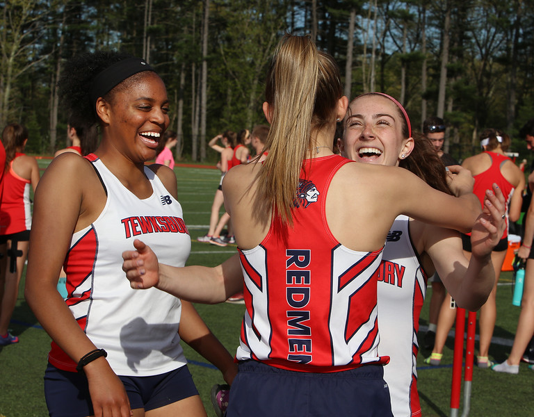 Tewksbury vs North Andover girls and boys track & field. From left, Tewksbury's Stephanie Baptiste, Cassidy Gruning, and Marissa Ladderbush, after Gruning and Ladderbush ran in the 100M, Ladderbush finishing second. (SUN/Julia Malakie)