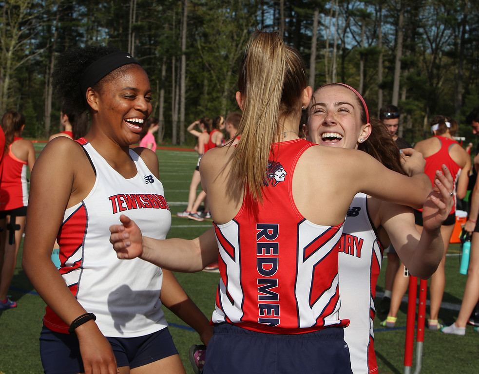 . Tewksbury vs North Andover girls and boys track & field. From left, Tewksbury\'s Stephanie Baptiste, Cassidy Gruning, and Marissa Ladderbush, after Gruning and Ladderbush ran in the 100M, Ladderbush finishing second. (SUN/Julia Malakie)