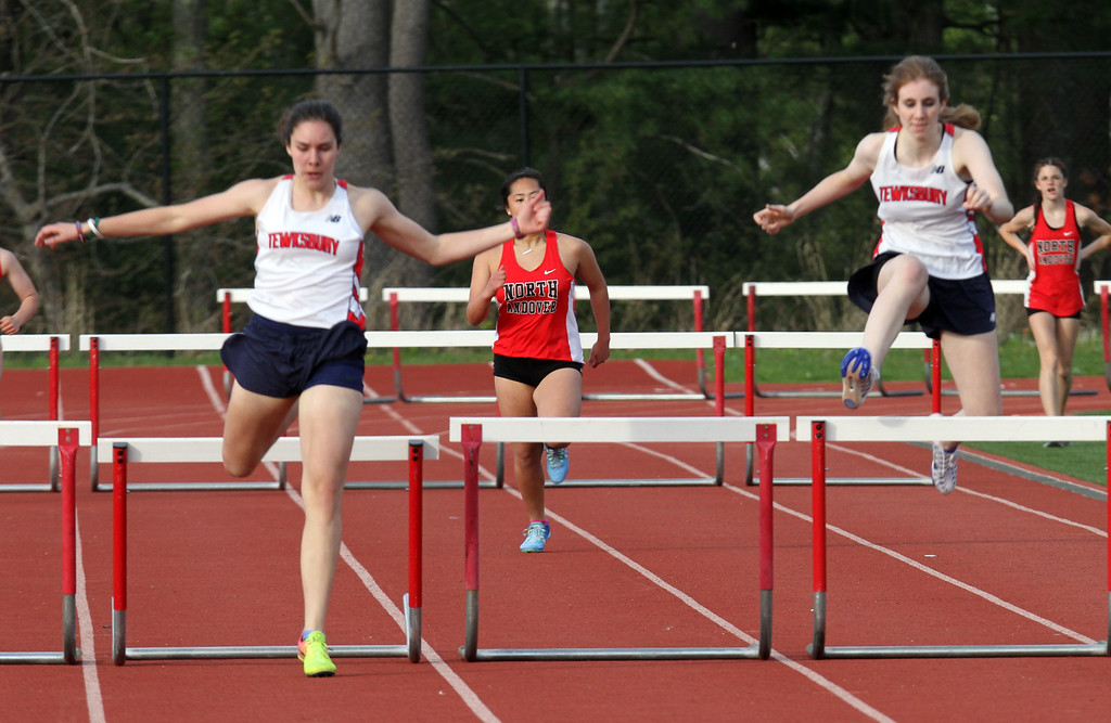 . Tewksbury vs North Andover girls and boys track & field. Tewksbury\'s Sarah Polimeno, left, and Kerry Shea, right, in 400M hurdles. At center is Samantha Lee of North Andover. (SUN/Julia Malakie)