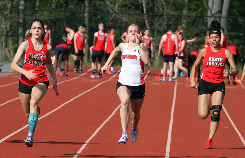 Tewksbury vs North Andover girls and boys track & field. Finish of the 100M, from left, winner Ava Nassar of North Andover, Marissa Ladderbush of Tewksbury who finished second, and Angie Coa of North Andover. (SUN/Julia Malakie)