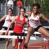 Tewksbury vs North Andover girls and boys track & field. Tewksbury's Stephanie Baptiste, right, winner of the 100M hurdles in 15.9, Sarah Polimeno, left, and North Andover's Sarah Lavery, center, who finished second. (SUN/Julia Malakie)