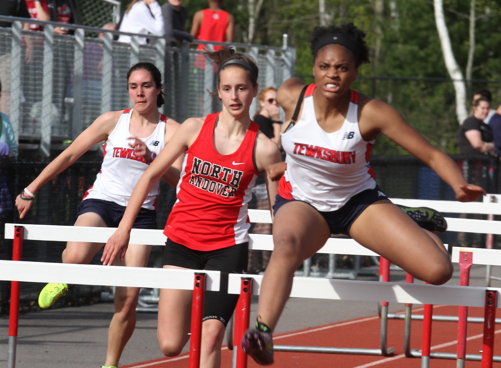 . Tewksbury vs North Andover girls and boys track & field. Tewksbury\'s Stephanie Baptiste, right, winner of the 100M hurdles in 15.9, Sarah Polimeno, left, and North Andover\'s Sarah Lavery, center, who finished second. (SUN/Julia Malakie)