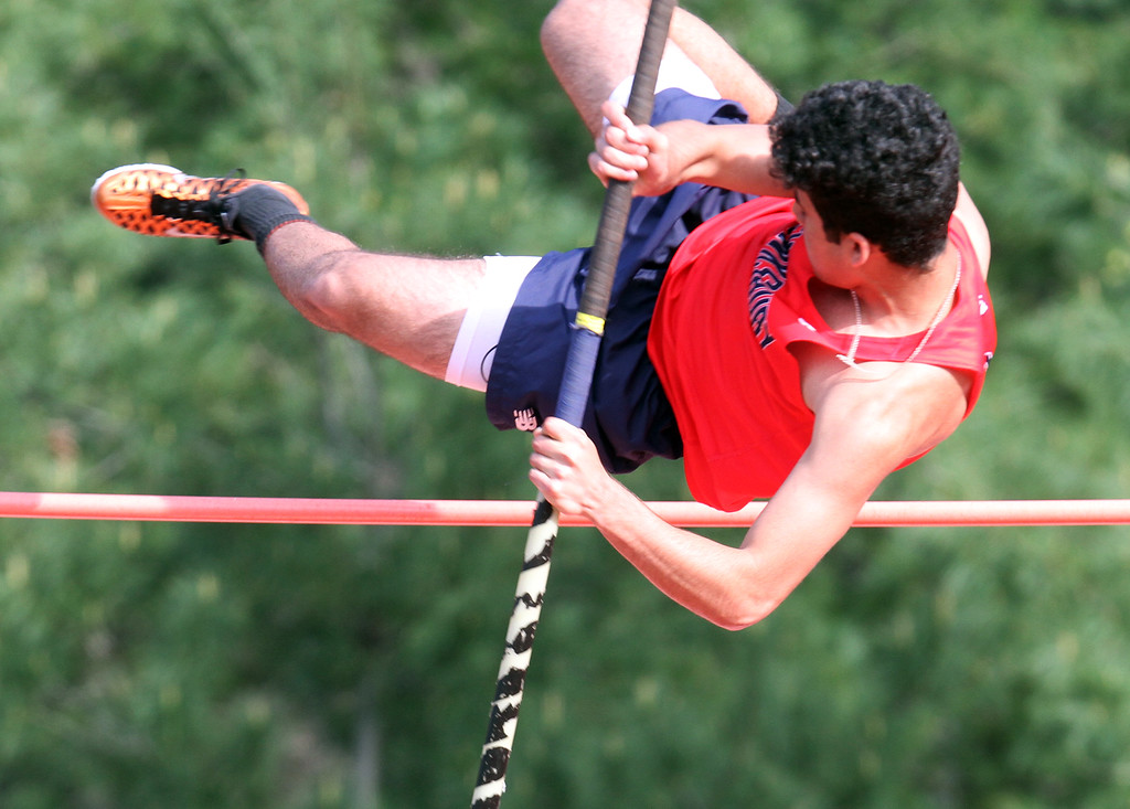 ". Tewksbury vs North Andover girls and boys track & field. Elias Melki of Tewksbury clears 8\'6"" in Pole Vault. (SUN/Julia Malakie)"