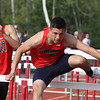 Tewksbury vs North Andover girls and boys track & field. Steven Wilson of Tewksbury, winner of 110M hurdles in 15.5. (SUN/Julia Malakie)