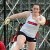 Tewksbury vs North Andover girls and boys track & field. Krista Stracqualursi of Tewksbury winds up in discus. (SUN/Julia Malakie)