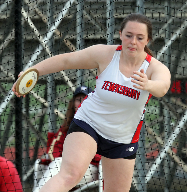 . Tewksbury vs North Andover girls and boys track & field. Krista Stracqualursi of Tewksbury winds up in discus. (SUN/Julia Malakie)