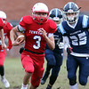 Tewksbury vs Wilmington Thanksgiving Day football. Tewksbury's Shane Aylward (3), running for Tewksbury's first TD, followed by teammate Brodie Tirrell (81) and Marcello Misuraca (25). (SUN/Julia Malakie)