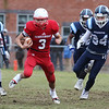 Tewksbury vs Wilmington Thanksgiving Day football. Tewksbury's Shane Aylward (3), running for Tewksbury's first TD, followed by Wilmington's Marcello Misuraca (25), left, and Ryan LeBlanc (34). (SUN/Julia Malakie)