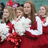 Tewksbury vs Wilmington Thanksgiving Day football. Tewksbury cheerleaders, from left, Jillian Mantel, Colleen Crail, Zoe Kalogeropoulos and Kasey Saunders, all sophomores. (SUN/Julia Malakie)