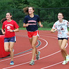 Tewksbury cross country runners, from left, junior Rachel Sessa, and senior captains Lauren Polimeno, and Rachel's sister Emily Sessa. The Sessa sisters switched from soccer to cross country this fall, but know much of the team from running indoor and spring track. (SUN/Julia Malakie)