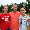 Tewksbury cross country runners, junior Rachel Sessa, left, and her sister, senior Emily Sessa, right, with coach Peter Molloy. The Sessa sisters switched from soccer to cross country this fall, but know much of the team from running indoor and spring track. (SUN/Julia Malakie)