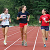 Tewksbury cross country runners, from left, seniors Emily Sessa and Lauren Polimeno, and Emily's sister Rachel Sessa, a junior. The Sessa sisters switched from soccer to cross country this fall, but know much of the team from running indoor and spring track. (SUN/Julia Malakie)