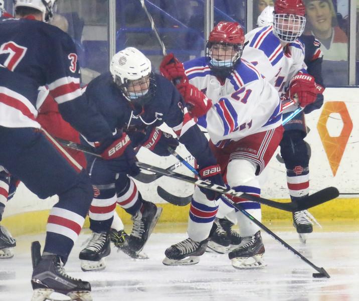 Tewksbury vs Central Catholic boys hockey in MVC-1 championship. Central Catholic's Michael Dinges (16) and Tewksbury's Cole Stone (21). (SUN/Julia Malakie)