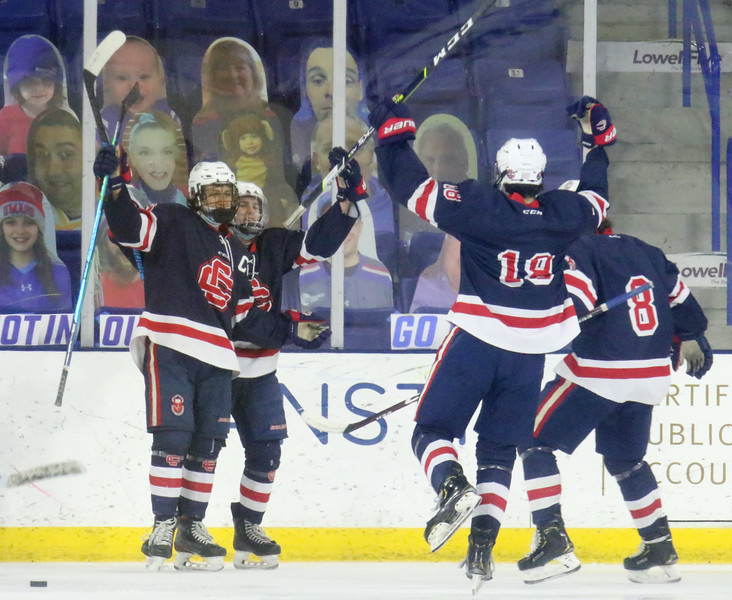 Tewksbury vs Central Catholic boys hockey in MVC-1 championship. Central Catholic players celebrate goal giving them a 3-0 lead. From left, Michael Dinges (16), who scored, Sean Gray (26), AJ Grenier (18) and Tyler DiBurro (8).  (SUN/Julia Malakie)