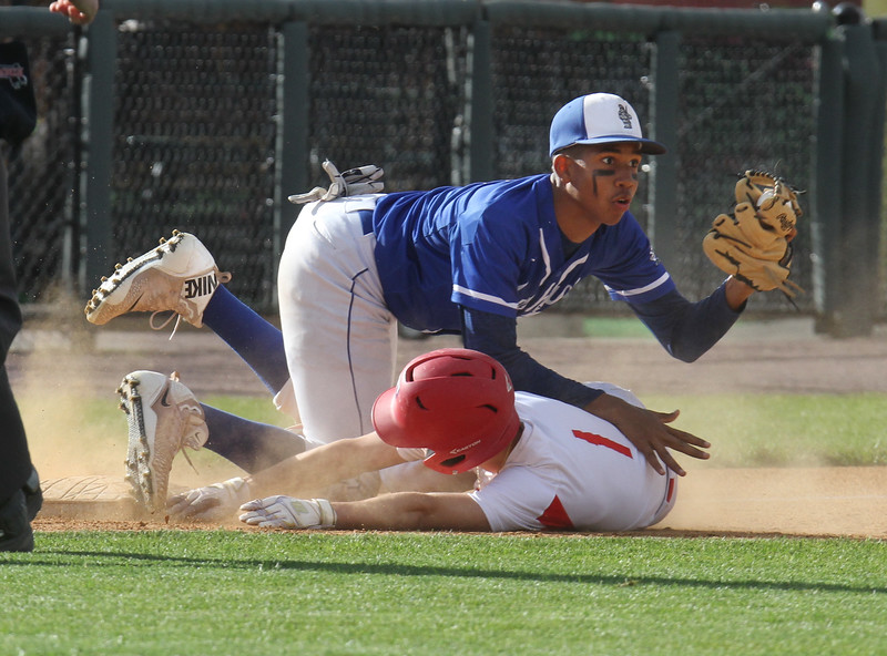 Tewksbury vs Methuen in Spinners Cup. Tewksbury's Tyler Keough (1) is tagged out at third by Methuen third baseman Chris Aracena (7), after stealing second and trying to reach third on a hit and run in the bottom of the first inning. (SUN/Julia Malakie)