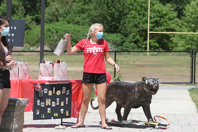 Tyngsboro High tennis team holds an Awesome Senior Tennis Recognition Day with a brief ceremony in front of the school. Senior tennis player Ella Kilmartin takes her gift bag.  (SUN/Julia Malakie)