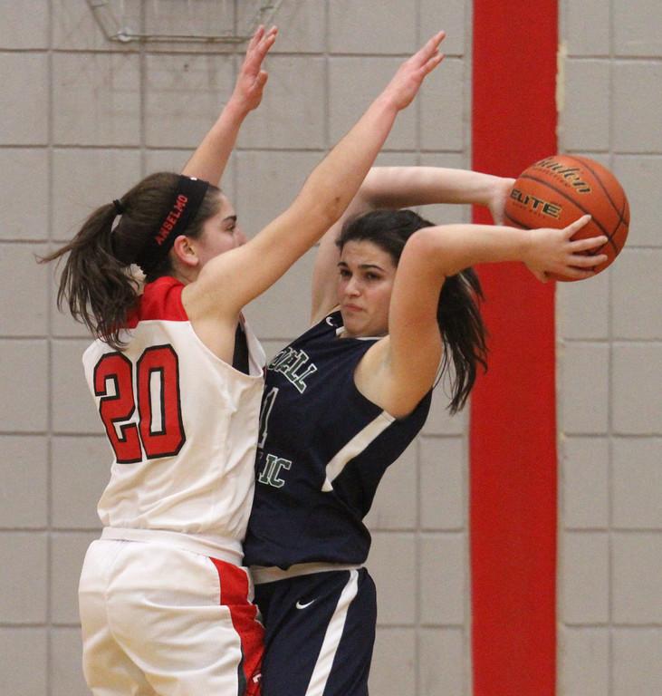 . Tyngsboro vs Lowell Catholic basketball. Tyngsboro\'s Sara Anselmo (20) and Lowell Catholic\'s Maggie Penta (11). (SUN/Julia Malakie)