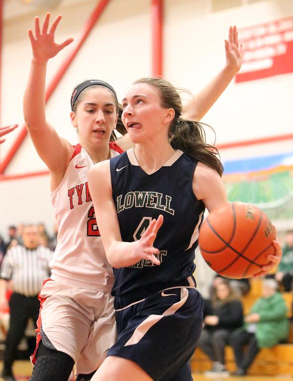 . Tyngsboro vs Lowell Catholic basketball. Tyngsboro\'s Sara Anselmo (20) and Lowell Catholic\'s Mary Tibbetts (4). (SUN/Julia Malakie)
