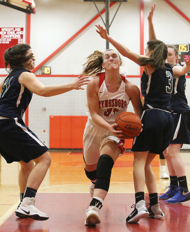 . Tyngsboro vs Lowell Catholic basketball. Tyngsboro\'s Katie Hurynowicz (33) and Lowell Catholic\'s Maggie Penta (11) and Emily Jussaume (3). (SUN/Julia Malakie)