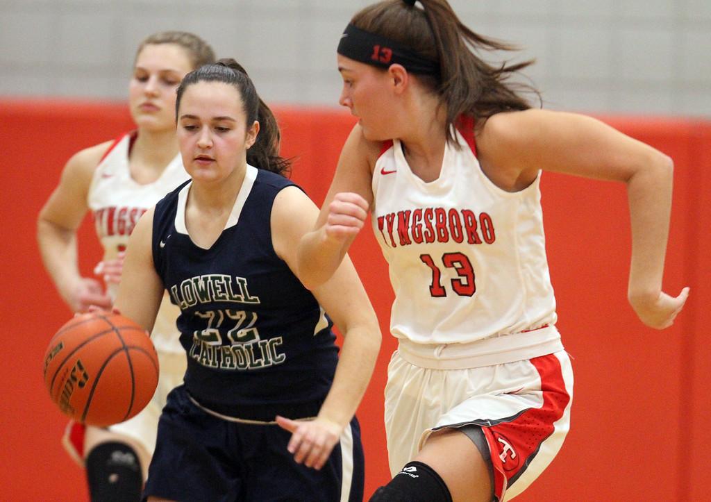 . Tyngsboro vs Lowell Catholic basketball. Lowell Catholic\'s Emily Bartlett (22) and Tyngsboro\'s Amanda Leal (13). SUN/Julia Malakie)