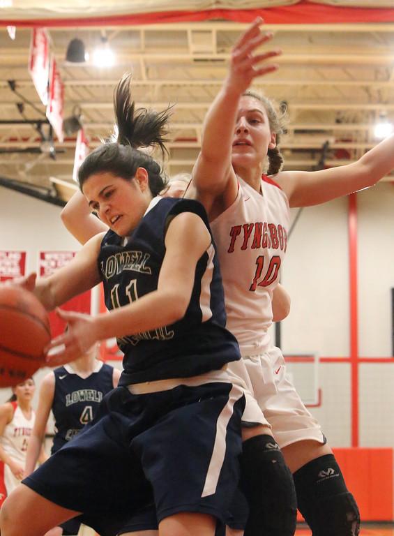 . Tyngsboro vs Lowell Catholic basketball. L0well Catholic\'s Maggie Penta (11) and Tyngsboro\'s Emma Smolinski (10). (SUN/Julia Malakie)