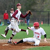 Tyngsboro vs Millbury baseball. Tyngsboro's JT Shaffer (10) is safe at second with a stolen base in the bottom of the first inning, Millbury shortstop Tim Cunningham (5) fielding. (SUN/Julia Malakie)