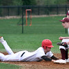 Tyngsboro vs Millbury baseball. Tyngsboro's Phil Sutherland (11) dives back safe to second base in the bottom of the fourth inning, Millbury second baseman Sean Kelly (2) fielding. (SUN/Julia Malakie)