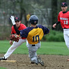 Littleton vs Tyngsboro baseball. Littleton's Jacob Montepeluso (10) is out trying to steal second, with Tyngsboro second baseman Alex Makos (14) fielding, backed up by shortstop Chris Ausiello (12) in the bottom of the fourth inning. (SUN/Julia Malakie)