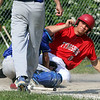 Tyngsboro vs Lunenburg baseball. Tyngsboro's JT Shaffer (10) scores from second on a double by Ryan Guillmette after Lunenburg catcher Dylan Adamson (24) bobbled the throw in the top of the fourth inning. SUN/Julia Malakie